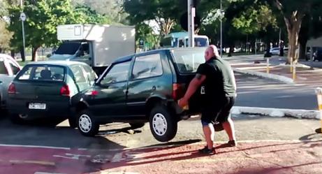 Strongman Literally Picks Up Car Blocking Bike Lane