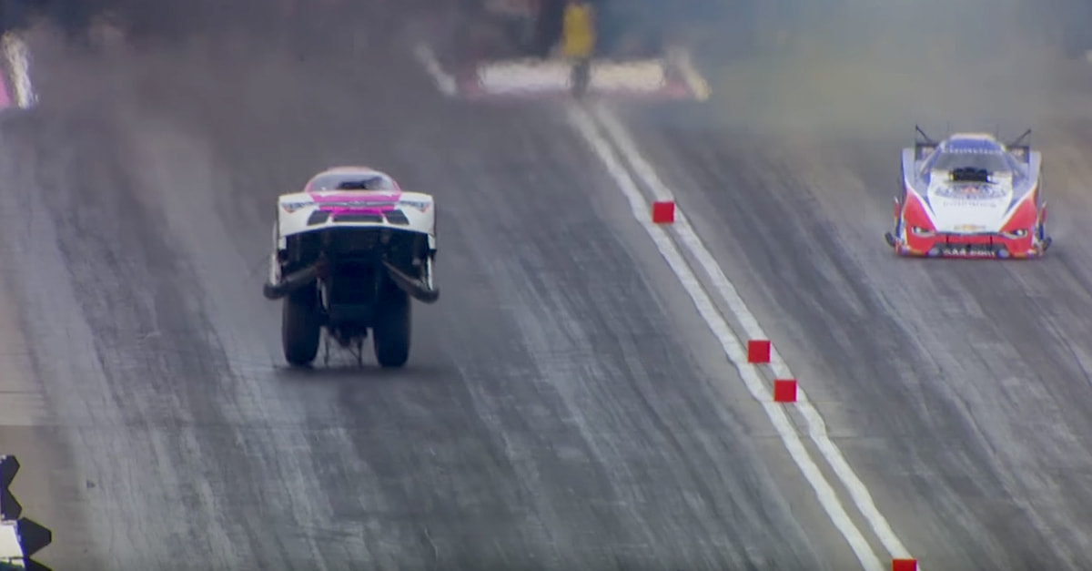 Race Car Driver Finishes Race Doing A Wheelstand!