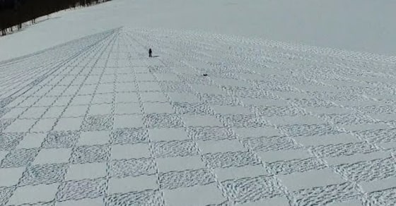 Man Creates Remarkable Large Scale Snow Murals with Just His Snowshoes!