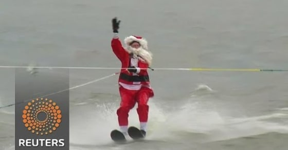 The Grinch Shows up as Santa and His Helpers Make a Splash Water-Skiing