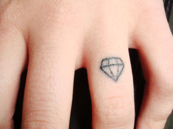 20 adorable wedding ring tattoos our love will endor guff for Wedding ring tattoos cost